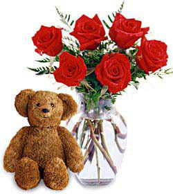 birthday gift ideas, birthday flowers with a bear, teddy bear with flowers