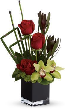 red roses, leucadendron, green cymbidium orchids and green button spray chrysanthemums accented with fresh greenery, contemporary floral arrangements, roses