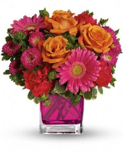 "This brilliant bouquet of lush orange roses, hot pink gerberas, carnations and matsumoto asters are accented with bupleurum and variegated pittosporum. Approximately 11"" W x 11"" H As Shown ($59.95) Deluxe ($69.95) Premium ($79.95) Shown The floral arrangement is designed as shown in the picture. Quantity:"