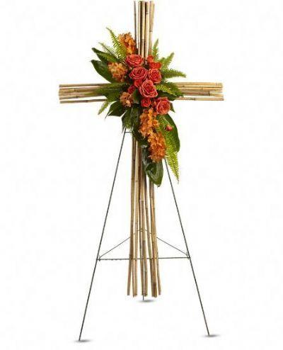 tropical sympathy flowers, orange orchids, river cane, sword fern, ti leaves, sympathy cross floral arrangement