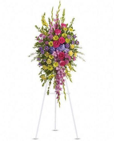 purple, lavender, pink and yellow funeral floral standing spray