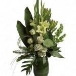 Zen flower arrangement, green, leaf lined vase, lotus pod, roses, mums, gladioli, summer bouquet