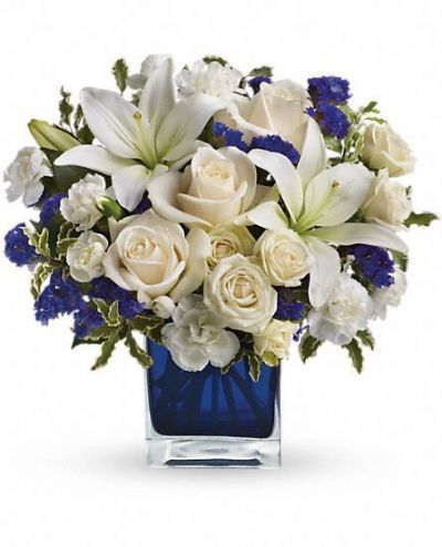 snow lilies, roses, carnations, purple statice, green pitta negra