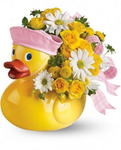 ceramic duck filled with yellow and white blooms, gift for new baby girl, flower arrangement for new baby