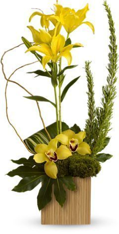 lilies, orchids, yellow flower arrangement