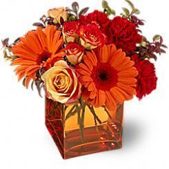 summer bouquet, gerbera daisies, orange roses, red carnations