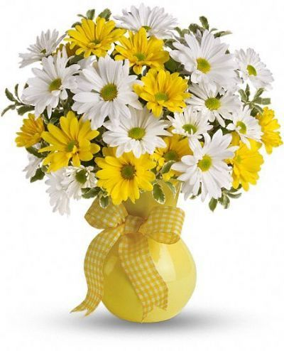 The bright bouquet includes white daisy spray chrysanthemums, yellow daisy spray chrysanthemums and bupleurum accented with fresh greenery.